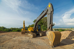 Желтое фото машинного оборудования Backhoe стоковое фото rf