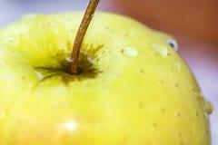 Желтое яблоко конец вверх Стоковое Фото