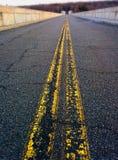 Желтые линии на дороге Стоковая Фотография RF