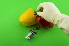 Желтые и красные перцы GMO Стоковое Изображение RF