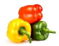 Желтые, красные и зеленые перцы на белой предпосылке Стоковая Фотография RF