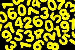 Желтые номера на черноте Стоковые Фото