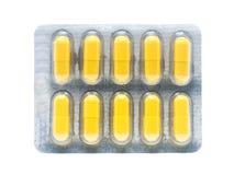 Желтые пилюльки капсул желатина в пакете волдыря Стоковые Фото