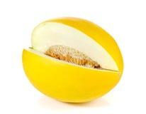 Желтые половины отрезка дыни на белой предпосылке Стоковое фото RF