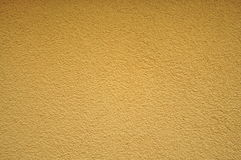 Желтые текстура и предпосылка стены homogen Стоковая Фотография
