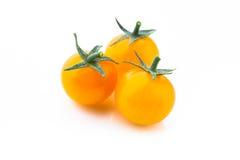 Желтые томаты вишни на белизне Стоковые Фотографии RF