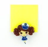 Желтый блокнот с зажимом девушки военно-морского флота Стоковая Фотография RF