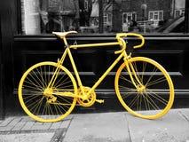 Желтый велосипед Стоковые Фото