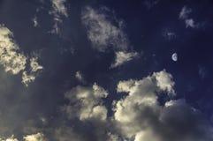 желтый заход солнца с луной и облаками стоковое фото rf