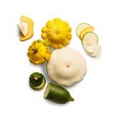 Желтый, зеленый и круглый courgette изолированный на белой предпосылке Стоковые Изображения