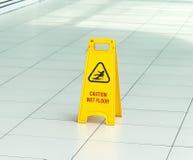 Желтый знак тот сигналы тревоги для влажного пола стоковое изображение