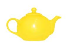 Желтый керамический чайник изолировано Стоковые Фото