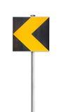 Желтый дорожный знак поворота изолированный на белизне стоковые фото