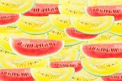 Желтый цвет арбуза куска на белой предпосылке Стоковое Изображение
