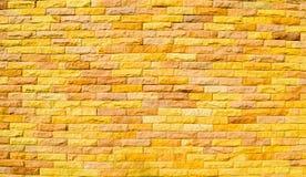 желтый цвет каменной стены кирпича предпосылки Стоковое Фото