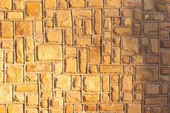 желтый цвет каменной стены предпосылки Стоковая Фотография RF