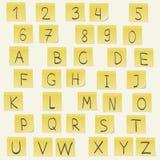 желтый цвет стикеров теней предпосылки серый изолированный Стоковое Изображение RF
