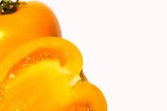 желтый цвет томата предпосылки белый Стоковые Изображения