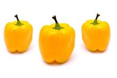 Желтый цвет Capsicums на белизне Стоковая Фотография RF