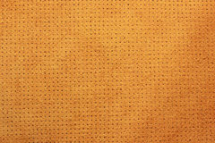 Желтым пефорированная бархатом кожаная предпосылка текстуры Стоковое Изображение RF