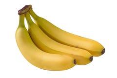 3 желтых банана изолированного на белой предпосылке Стоковые Фотографии RF