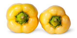 2 желтых болгарского перца лежа рядом с Стоковые Изображения