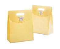 2 желтых бумажных изолированной сумки Стоковая Фотография