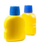 2 желтых бутылки при краска изолированная на белой предпосылке Стоковое фото RF