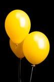 3 желтых воздушного шара изолированного на черноте Стоковые Изображения