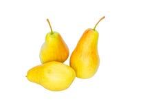 3 желтых груши на белой предпосылке Стоковые Изображения