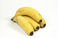 4 желтых зрелых банана изолированного на белизне Стоковое Изображение
