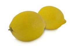 2 желтых лимона изолированного на белой предпосылке Стоковые Изображения