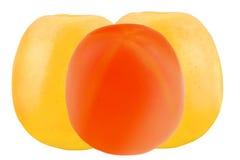 2 желтых яблоки и хурмы изолированных на белой предпосылке Стоковые Изображения