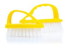 2 желтых scrubbrushes  Стоковые Фото