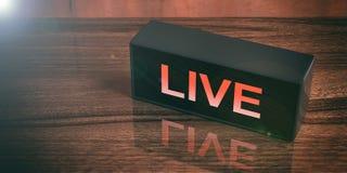 ЖИВИТЕ на черном ящике изолированном на деревянной предпосылке иллюстрация 3d Стоковое Изображение RF