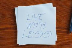 Живите с более менее написанный на примечании Стоковые Изображения