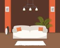 Живущая комната в оранжевых и коричневых цветах с белой софой Стоковые Изображения
