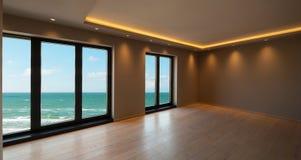 Живущая комната в современной квартире, вид на море стоковое изображение rf