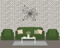 Живущая комната с зеленой мебелью и круглыми часами Стоковые Изображения RF