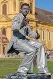 Живущая статуя человека, серебрит одетый Стоковое Изображение RF