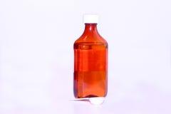 жидкостная ложка красного цвета микстуры стоковые фото