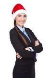 Жизнерадостная коммерсантка с шлемом santa стоковая фотография