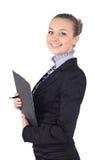 Жизнерадостная красивейшая женщина дела с сочинительством доски сзажимом для бумаги, isolat Стоковое Изображение RF