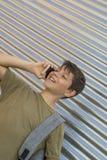 Жизнерадостный мальчик используя мобильный телефон стоковые фото