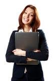Жизнерадостная коммерсантка держа компьтер-книжку стоковая фотография