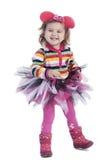 Жизнерадостная маленькая девочка на белой предпосылке Стоковая Фотография