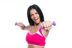 Жизнерадостная разминка женщины фитнеса с гантелями Стоковые Фотографии RF
