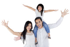 Жизнерадостная семья с оружиями вверх смотрит счастливой Стоковое Изображение