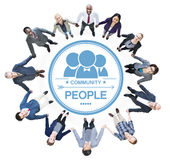Жизнерадостные бизнесмены держа руки формируя круг Стоковое Изображение