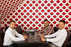 Жизнерадостные бизнесмены на встрече Стоковое Изображение RF